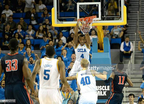 Norman Powell of the UCLA Bruins dunks against the Cal State Fullerton Titans during the first half at Pauley Pavilion on December 3 2014 in Los...