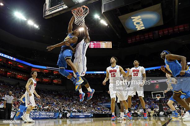 Norman Powell of the UCLA Bruins dunks the ball against Ben Emelogu of the Southern Methodist Mustangs during the second round of the 2015 NCAA Men's...