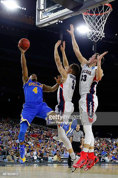Norman Powell of the UCLA Bruins goes to the basket as Kyle Dranginis and Kyle Wiltjer of the Gonzaga Bulldogs defend during a South Regional...