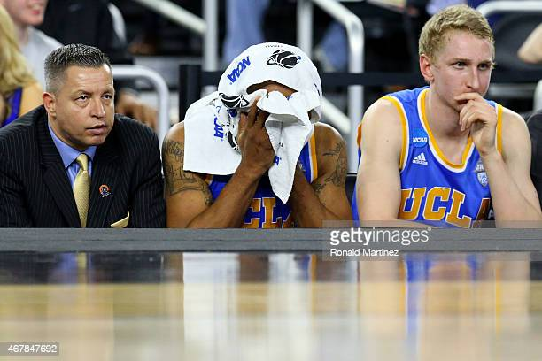Norman Powell of the UCLA Bruins reacts on the bench in the closing minutes against the Gonzaga Bulldogs during a South Regional Semifinal game of...