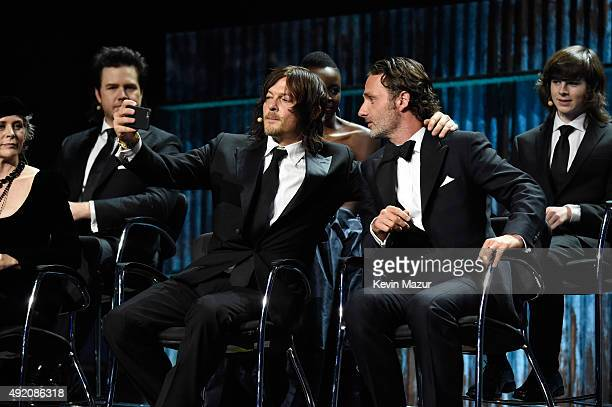 """Norman Reedus and Andrew Lincoln attend AMC's """"The Walking Dead"""" season 6 fan premiere event at Madison Square Garden on October 9, 2015 in New York..."""