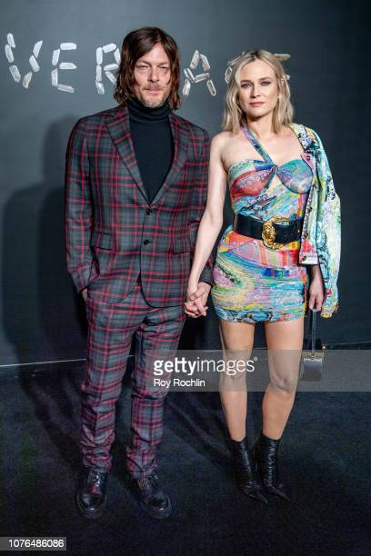 Norman Reedus and Diane Kruger attend the the Versace fall 2019 fashion show at the American Stock Exchange Building in lower Manhattan on December...