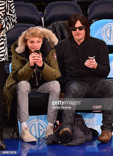 Norman Reedus and Mingus Reedus attend Brooklyn Nets vs New York Knicks at Madison Square Garden on December 2 2014 in New York City