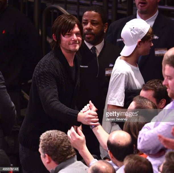 Norman Reedus and Mingus Reedus attend the Chicago Bulls vs New York Knicks game at Madison Square Garden on December 11 2013 in New York City