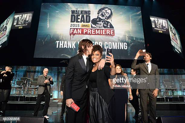 """Norman Reedus and Yvette Nicole Brown attend AMC's """"The Walking Dead"""" season 6 fan premiere event at Madison Square Garden on October 9, 2015 in New..."""