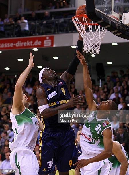 Norman Richardson of Trier tries to block Ansu Sesay of Berlin during the Bundesliga game between TBB Trier and ALBA Berlin at the Trier Arena on...