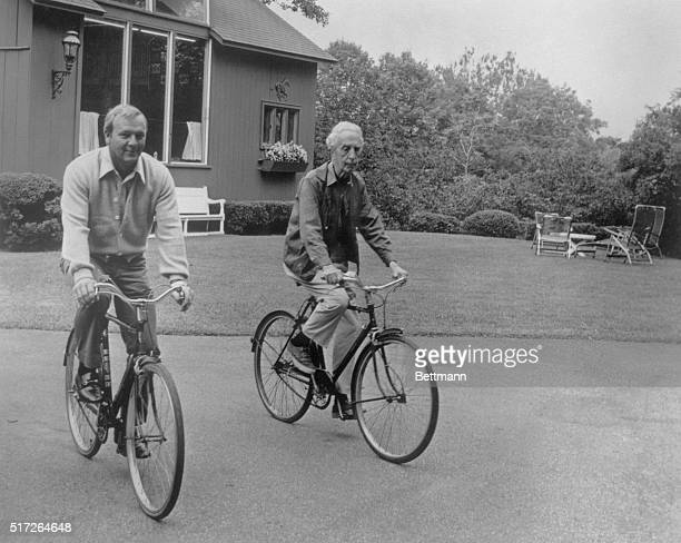 Norman Rockwell acknowledged dean of American artists and Arnold Palmer one of the great golfers of our time do a little bicycling outside the...
