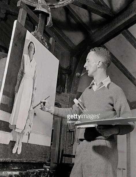 Norman Rockwell, artist. Photo shows Rockwell painting with smoking pipe in his mouth.