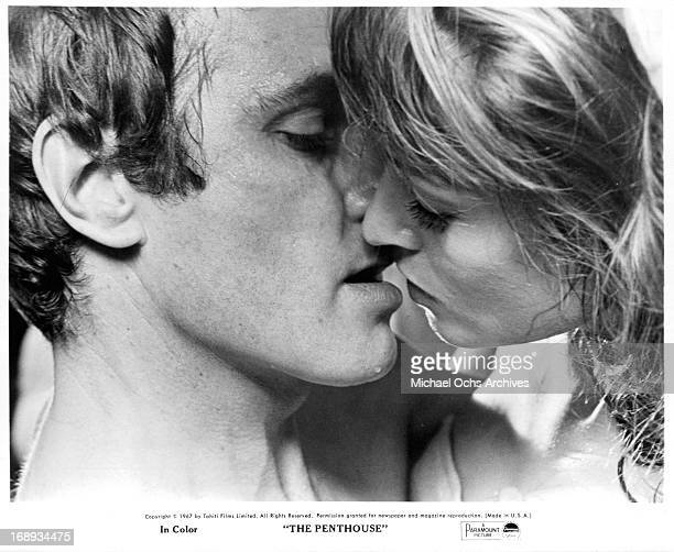 Norman Rodway and Suzy Kendall take their attraction to another level in a scene from the film 'The Penthouse' 1967
