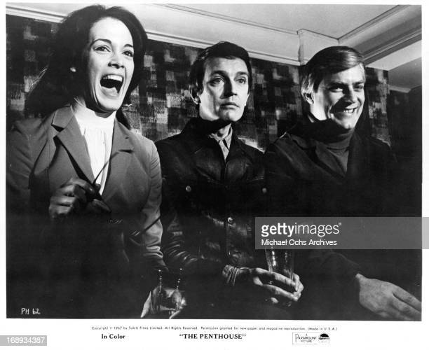Norman Rodway Martine Beswick and Tony Beckley sitting side by side in a scene from the film 'The Penthouse' 1967