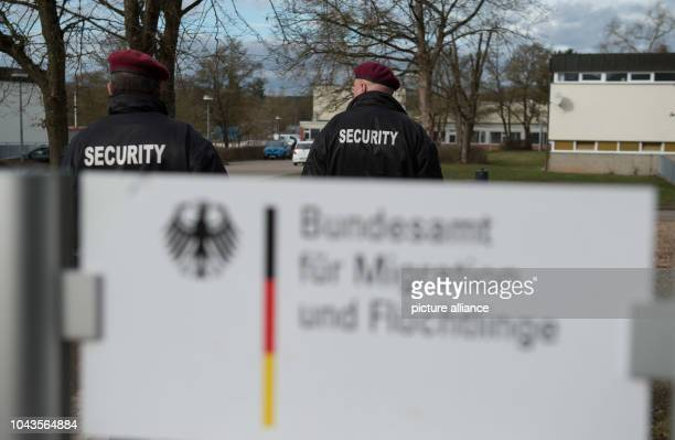 Norman Schmidt and Werner Baestle security guards with Siba Security GmbH patrol the state initial reception center in the Reinhardt barracks...