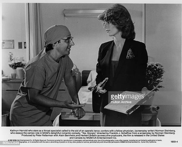 Norman Steinberg talks with Kathryn Harrold in a scene from the movie Yes Giorgio circa 1982