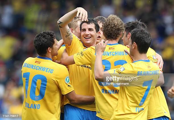 Norman Theuerkauf of Braunschweig celebrates scoring with team mates during the Third League match between Eintracht Braunschweig and 1. FC...
