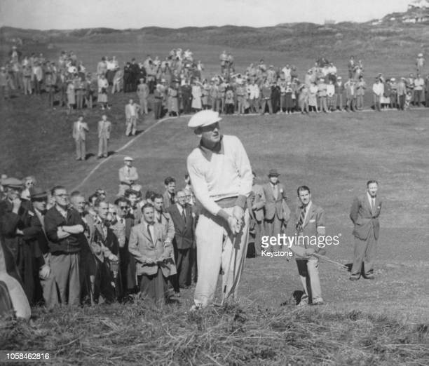 Norman Von Nida of Australia chips onto the 9th green from the rough as spectators look on during the 80th Open Championship on 6 July 1951 at the...