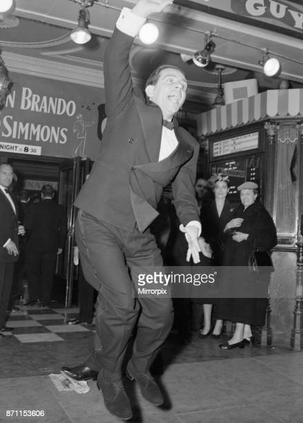 Norman Wisdom seen here waving to the crowds at the premiere of Guys and Dolls at the Empire Theatre in Leicester Square 19th September 1956