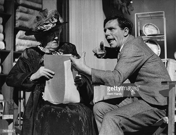 Norman Wisdom the British comedian in a scene from his debut film 'Trouble In Store' directed by John Paddy Carstairs for GFD/Two Cities He sits with...
