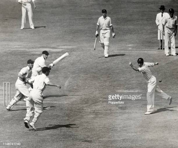 Norman Yardley the England captain dances with excitement as Len Hutton makes a great effort to take a chance offered by Ken Viljoen during South...