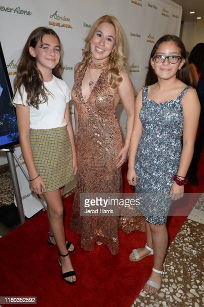 Normandie DiCaprio, Ariel Michael and Natalia Canela arrive at Special Screening of 'Never Alone' at Arena Cinelounge on October 10, 2019 in...