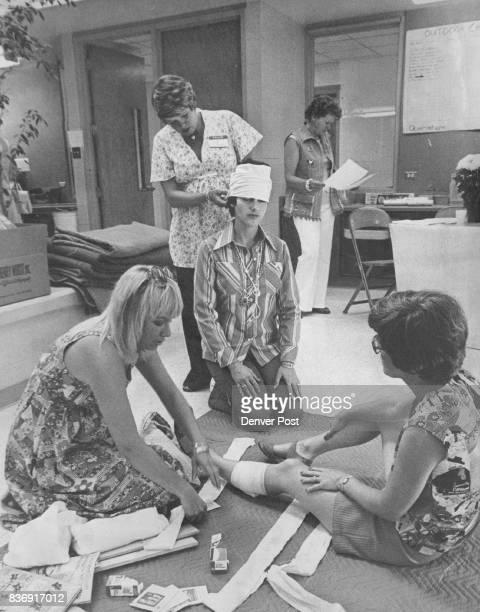 Normandy Elementary School Normandy Elementary Mothers Get FirstAid Training Sue Burt left prepares Ann Michel for splint as nurse Jeanie Mack...