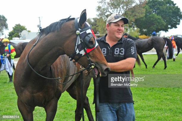 Normandy Lad and strapper Jamie Opperman after winning the Gilchrist Co BM58 Handicap at Donald Racecourse on March 22 2018 in Donald Australia