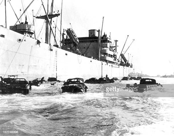 Normandy landings American amphibious vehicules come and go between ships and shore They are loaded with petrol jerrycans France World War II Private...