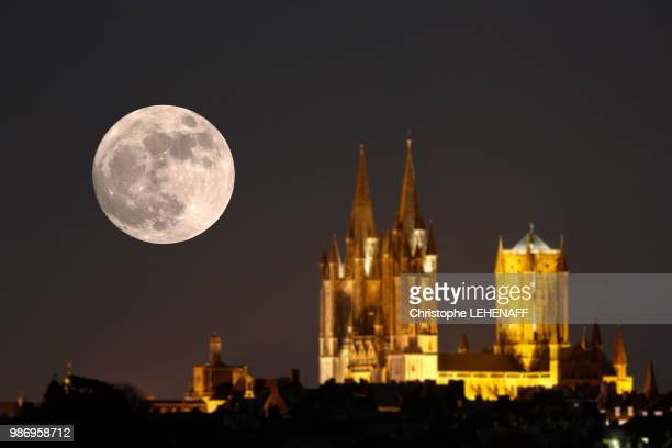 normandy. manche. coutances. super moon 2018. the super moon above the cathedral on january 1st, 2018. focus on the moon. - supermoon stock pictures, royalty-free photos & images