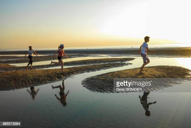 Normandy, Three kids playing on the beach