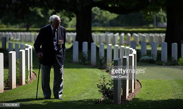 Normandy Veteran 90yearold Eric Gibbons looks at the headstones of fallen comrades at a remembrance and wreath laying ceremony to commemorate the...