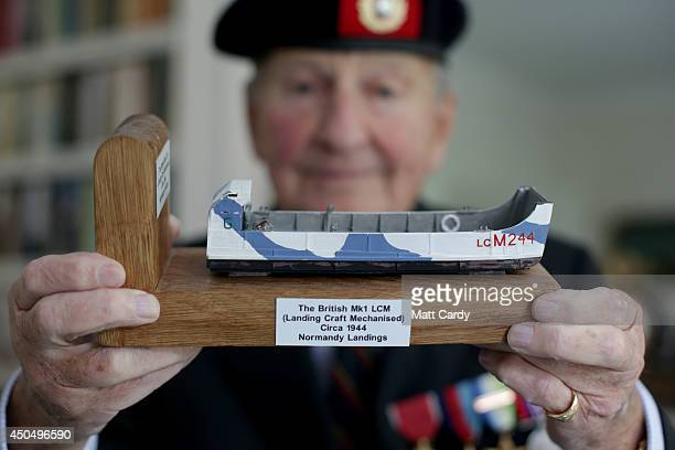 Normandy veteran John Brunel Cohen holds a model of a LCM for a photograph at his home in Chelsea on May 14 2014 in London England On DDay June 6...