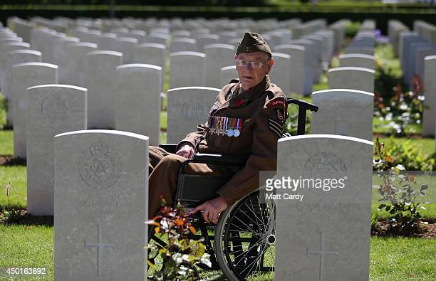 Normandy veteran Ken Scott 98 who was an infantry sergeant with the Durham Light Infantry on Gold Beach on DDay looks at headstones in the cemetery...
