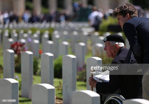 Normandy Veteran looks at headstones in the cemetery following a service at Bayeux Cemetary during DDay 70th anniversary commemorations on June 6...