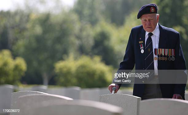 Normandy Veteran looks at the headstones of fallen comrades at a remembrance and wreath laying ceremony to commemorate the start of the DDay landings...