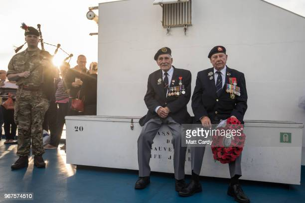 Normandy veterans attend a at sea wreath laying ceremony on the deck of the Brittany ferry from Portsmouth to Caen as they travel to Normandy in...