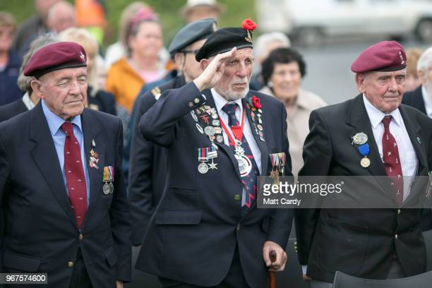 Normandy veterans attend a wreath laying ceremony at the Tactical Air Force Memorial besides Omaha Beach at ViervillesurMer in Normandy on June 4...