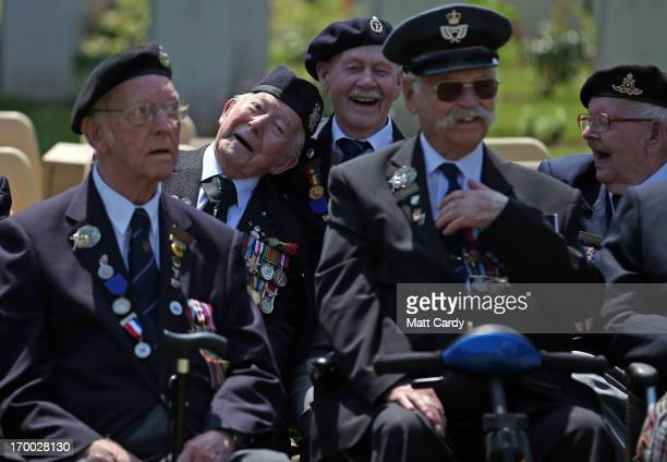 Normandy Veterans joke around as they attend a remembrance and wreath laying ceremony to commemorate the start of the DDay landings at Bayeux War...