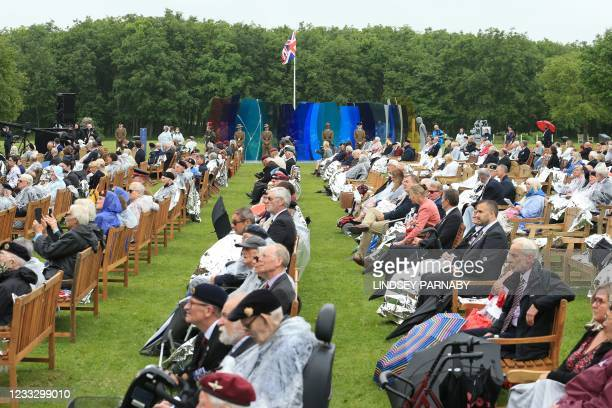 Normandy veterans, their families and friends mark the 77th anniversary of D-Day on June 6 at the British Normandy Memorial at the National Memorial...