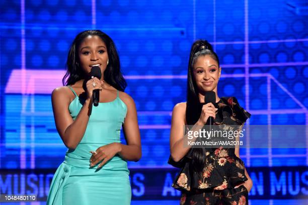 Normani and Liza Koshy speak onstage during the 2018 American Music Awards at Microsoft Theater on October 9 2018 in Los Angeles California