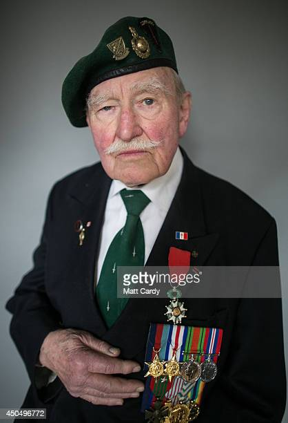 Normany veteran 90yearold Pat Churchill poses for a photograph at his home in Witney on March 20 2014 in Oxfordshire England On DDay June 6 1944 Pat...