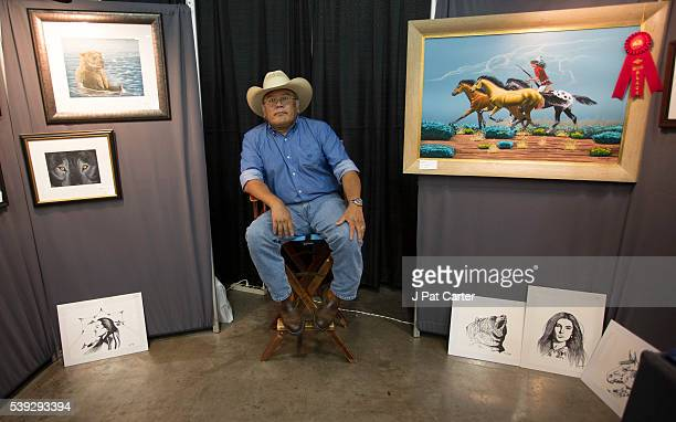 Norris Chee a Navajo sits in his booth at the Red Earth Native American Festival Friday June 10 2016 in Oklahoma City waiting to sell his art work