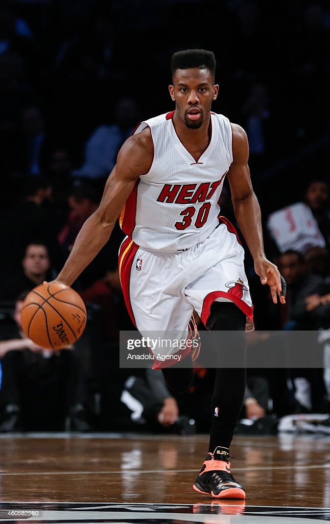 Norris Cole #30 of Miami Heat in action during a basketball game between Miami Heat and Brooklyn Nets at the Barclays Center on December 16, 2014 in the Brooklyn Borough of New York City.