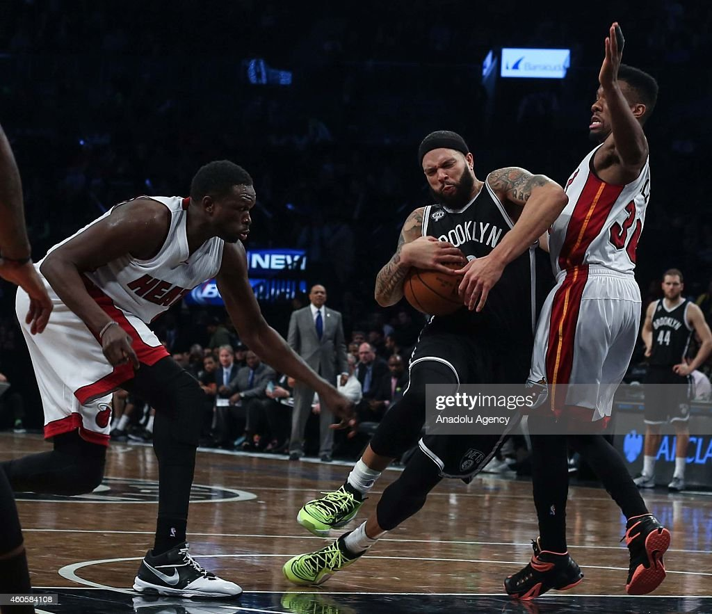 Norris Cole (R) of Miami Heat vies with Deron Williams (C) of Brooklyn Nets during a basketball game between Miami Heat and Brooklyn Nets at the Barclays Center on December 16, 2014 in the Brooklyn Borough of New York City.