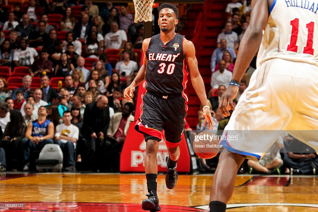 Norris Cole #30 of the Miami Heat advances the ball against the Philadelphia 76ers on March 8, 2013 at American Airlines Arena in Miami, Florida.