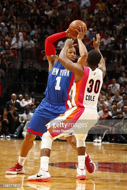 Norris Cole of the Miami Heat defends Sundiata Gaines of the New Jersey Nets on March 6 2012 at American Airlines Arena in Miami Florida NOTE TO USER...