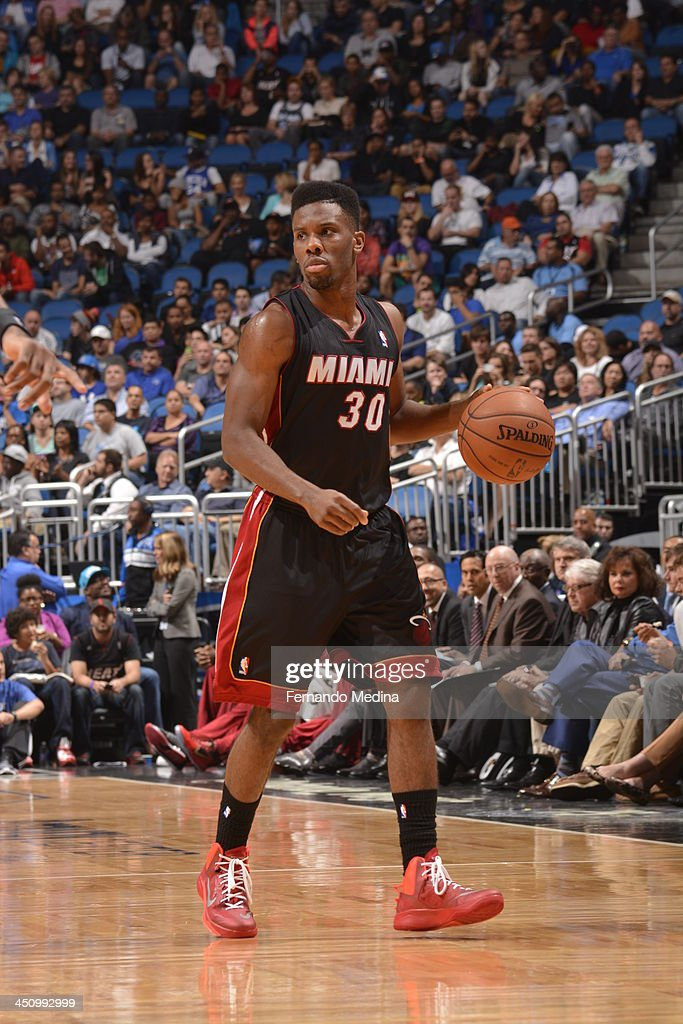 Norris Cole #30 of the Miami Heat dribbles the ball against the Orlando Magic during the game on November 20, 2013 at Amway Center in Orlando, Florida.