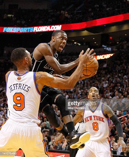 Norris Cole of the Miami Heat drives on Jared Jeffries of the New York Knicks during a game at American Airlines Arena on February 23 2012 in Miami...