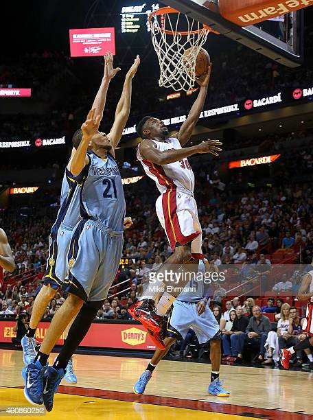 Norris Cole of the Miami Heat drives past Tayshaun Prince of the Memphis Grizzlies during a game at American Airlines Arena on December 27 2014 in...