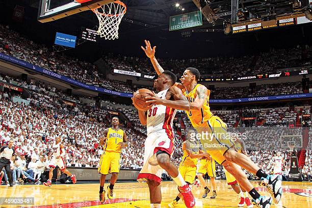 Norris Cole of the Miami Heat drives to the basket against Dominic McGuire of the Indiana Pacers in Game Seven of the Eastern Conference Finals...