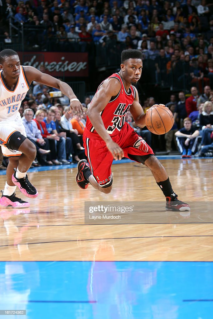 Norris Cole #30 of the Miami Heat drives to the basket against the Oklahoma City Thunder during an NBA game on February 14, 2013 at the Chesapeake Energy Arena in Oklahoma City, Oklahoma.