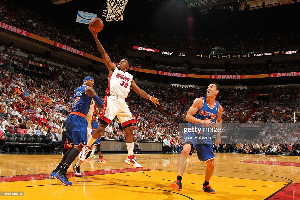 Norris Cole #30 of the Miami Heat goes up for the easy layup against the New York Knicks during a game on April 2, 2013 at American Airlines Arena in Miami, Florida.