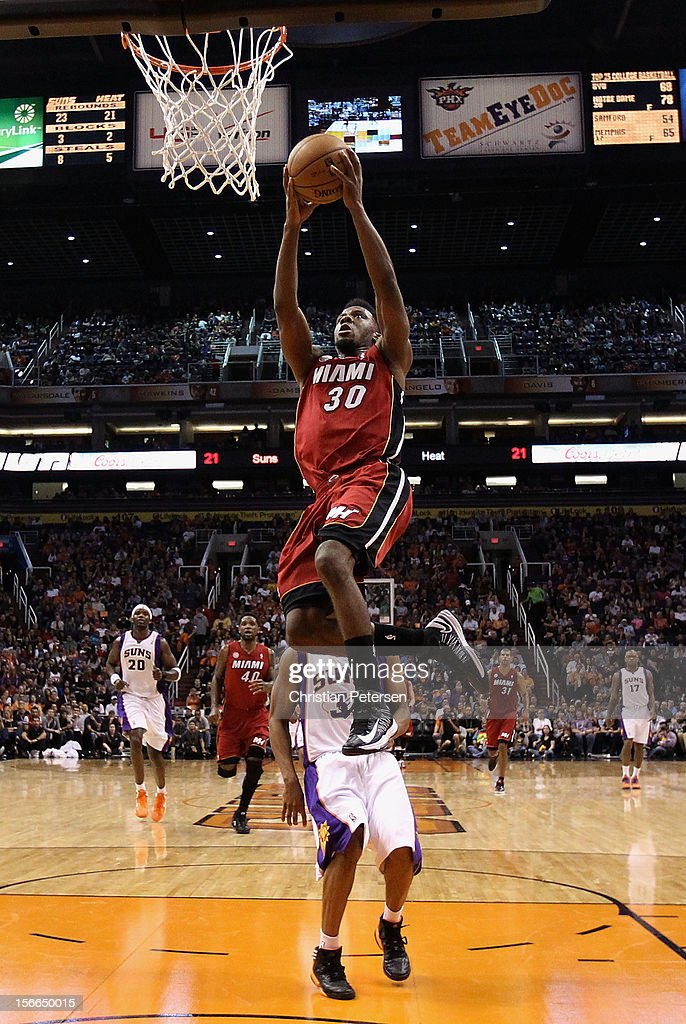 Norris Cole #30 of the Miami Heat goes up to slam dunk the ball during the NBA game against the Phoenix Suns at US Airways Center on November 17, 2012 in Phoenix, Arizona. The Heat defeated the Suns 97-88.
